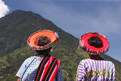 Woman in colorful round, woven  orange and red hats, Lake Atitlán, Santiago Atitlán Guatemala