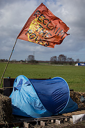 """© Licensed to London News Pictures . 21/03/2014 . Preston , UK . A flag with the words """" Reclaim the Power """" above a tent at the protest site . The Barton Moss anti-fracking demonstration camp today (Friday 21st March 2014) . Photo credit : Joel Goodman/LNP"""