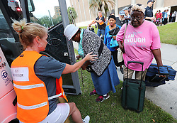 Volunteer Liz Degen, left, helps hundreds of local residents being evacuated from the city board buses at the Savannah Civic Center during a mandatory evacuation for Hurricane Irma on Saturday, September 9, 2017, in Savannah, Ga. Officials are expecting 1,500 to 3,000 without transportation to leave by buses that are being provided. Photo by Curtis Compton/Atlanta Journal-Constitution/TNS/ABACAPRESS.COM