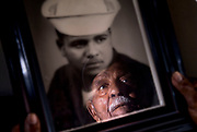 Santa Ana, CA, resident Ray Ross, 90, is reflected in a photo of himself as a sailor in the US Navy during World War II. Ross is a survivor of the Port Chicago disaster, the massive explosion that ripped through the U.S. Navy amunition depot in California on July 17, 1944 and where 320 people – most of them black – lost their lives. It was the worst U.S. military disaster on the mainland during World War II.