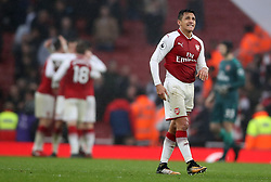 Arsenal's Alexis Sanchez at the end of the match as his teammates celebrate their victory