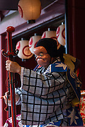 Kyogen performance at a stage in Senso-ji temple, during the Sanja matsuri. Asakusa, Tokyo, Japan. Sunday May 15th 2016 The Sanja matsuri is one of the biggest festivals in Japan. Taking place over the 3 days of the second weekend of May (May 13th to 15th) it features many mikoshi, or portable shrines, that are crrued around by local groups to bring blessings and prosperity to their neighbourhoods