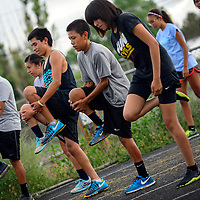 082113  Adron Gardner/Independent<br /> <br /> Window Rock Scout cross country runners stretch out at practice in Fort Defiance Wednesday.