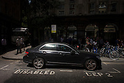 A parked car endures intensity of localised solar rays, reflected off the concave plate glass windows of one of the capital's newest skyscrapers known as the Walkie Talkie. The hotspot has surprised developers and passers-by below and which has already melted a parked car and left soft street fittings smouldering in Eastcheap Street, City of London, the capital's financial district. Thermometers placed in the street reached 144F (62 celsius) and city workers poured out of their offices at lunchtime to witness the strange phenomena of intense light and heat.