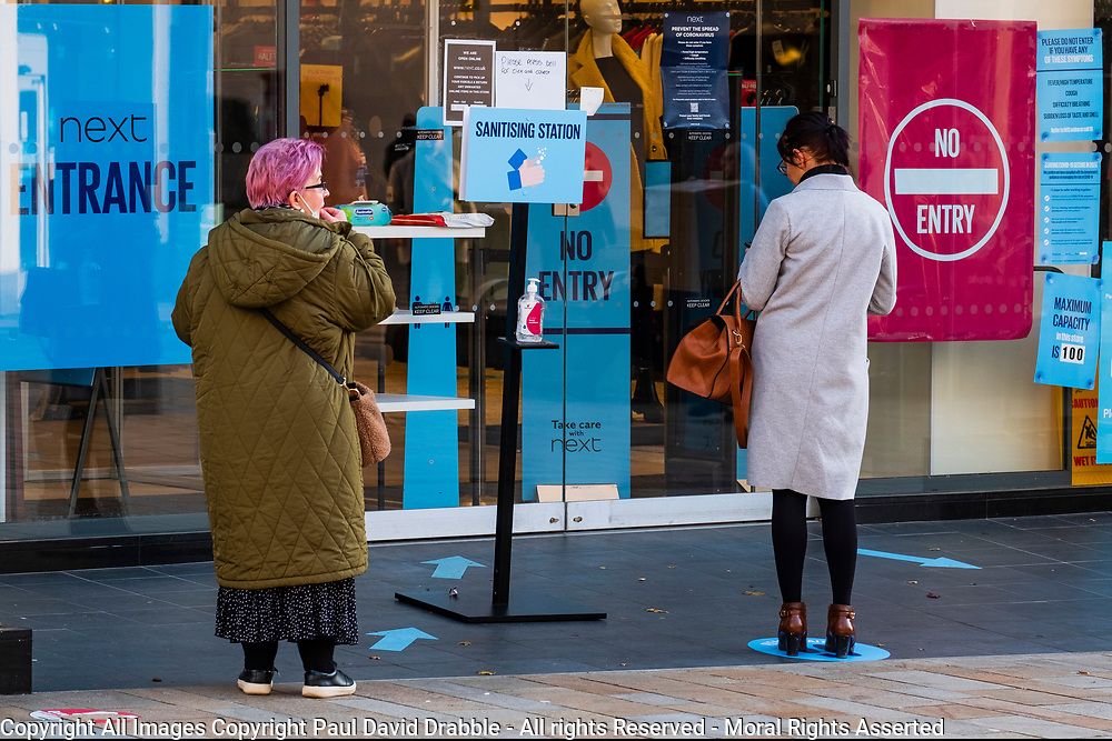 In an attempt to help reduce the spread of Corona Virus Next on the Moore, Sheffield has a sanitising station outside for customers using the click and collect service during the 2020/2021 COVID 19 pandemic<br /> <br /> 05 January 2020<br /> <br /> www.pauldaviddrabble.co.uk<br /> All Images Copyright Paul David Drabble - <br /> All rights Reserved - <br /> Moral Rights Asserted -