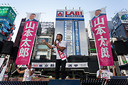 Former actor, Taro Yamamoto, leader of the anti-establishment political party Reiwa Shinsengumi, electioneering in Shimbashi for the 2020 Tokyo Gubernatorial elections. Tokyo, Japan. Thursday July 2nd 2020. The  elections for Tokyo Governor take place on Sunday July 5th. The incumbent, Yuriko Koike (not pictured) is expected to easily win reelection for her second term as leader of Japan's capital city. Photo by Damon Coulter/AFLO