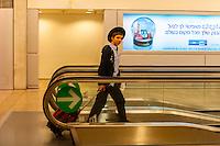 Hassidic Jewish boy on moving sidewalk, Ben Gurion International Airport, Israel.