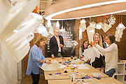 Fair visitors try their hands at designing and making their own lighting fixtures at Light Art, a Seattle lighting and fabrication design studio. The studio has also outfitted a van so the program, which they call ignite-create, can travel country wide.