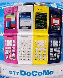 Modern mobile phones for sale in a Tokyo electronics shop in Japan