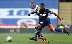 Reading's David Meyler (left) and Derby County's Max Lowe battle for the ball during the Sky Bet Championship match at the Madejski Stadium, Reading.