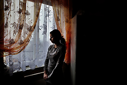 "Andrea Bandyová is seen inside her home in Ostrava, Czech Republic on March 2, 2012. Andrea and her sister Denisa Bandyová were among 18 Roma children who were represented in the D.H. and Others v. Czech Republic case, the first challenge to systemic racial segregation in education to reach the European Court of Human Rights. When this case was first brought in 2000, Roma children in the Czech Republic were 27 times more likely to be placed in ""special schools,"" intended for the mentally disabled, than non-Roma children. In 2007, the Grand Chamber of the European Court of Human Rights ruled that this pattern of segregation violated nondiscrimination protections in the European Convention on Human Rights. Despite this landmark decision, little change has occurred: the ""special schools"" have been renamed but follow the same substandard curriculum and Roma continue to be assigned to these schools in disproportionate numbers. The process of integration has barely begun."