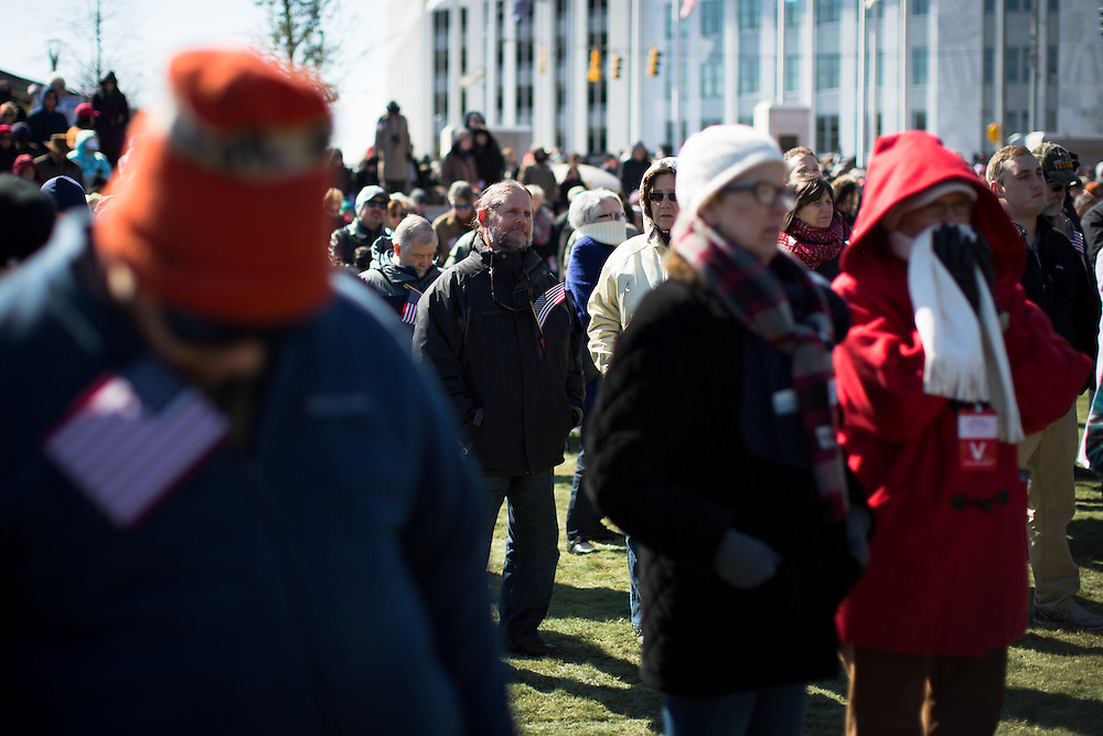 """Attendees listen during a speech by Franklin Graham at Liberty Plaza outside the Georgia Capitol as part of his """"Decision America Tour"""" in Atlanta on Wednesday, Feb. 10, 2016. Photo by Kevin D. Liles for The New York Times"""