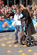 Her Majesty the queen and members of the royal family celebrate Saturday 29 April 2006 Queensday in the province flevoland in the cities  Zeewolde and almere.<br /> <br /> Hare Majesteit de Koningin en leden van de Koninklijke Familie vieren zaterdag 29 april 2006 Koninginnedag mee in de provincie Flevoland en wel in Zeewolde en Almere.<br /> <br /> On the Photo / Op dce foto: Princess maxima on Segway, an electric bicycle / Prinses Maxima op een Segway, een elektrische tweewieler.
