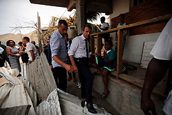 France's President Emmanuel Macron tries to find his way during his visit in the French Caribbean islands of St. Martin, Tuesday, Sept. 12, 2017. Macron is in the French-Dutch island of St. Martin, where 10 people were killed on the French side and four on the Dutch. Photo by Christophe Ena/Pool/ABACAPRESS.COM