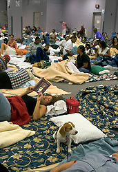 29 August, 2005. New Orleans, Louisiana.<br /> Hurricane Katrina hits New Orleans. Residents of the Hyatt Hotel are moved to the conference rooms where they await the approaching storm in sleeping quarters now occupied by thousands of apprehensive residents and trapped tourists. <br /> Photo; Charlie Varley.