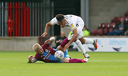 Rhys Bennett of Peterborough United in action with Stephen Humphrys of Scunthorpe United - Mandatory by-line: Joe Dent/JMP - 13/10/2018 - FOOTBALL - Glanford Park - Scunthorpe, England - Scunthorpe United v Peterborough United - Sky Bet League One
