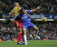 Photo: Lee Earle.<br /> Chelsea v Watford. The Barclays Premiership. 11/11/2006. Watford's Gavin Mahon (L) battles with Arjen Robben.