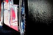 Image detail of racing tires on Bob Akin's red Porsche 962C at Mazda Raceway Laguna Seca during the Rolex Monterey Motorsports Reunion, Monterey, California, America west coast by Randy Wells