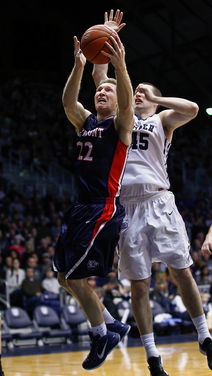INDIANAPOLIS, IN - DECEMBER 28: Reece Chamberlain #22 of the Belmont Bruins shoots the ball as Andrew Chrabascz #45 of the Butler Bulldogs defends at Hinkle Fieldhouse on December 28, 2014 in Indianapolis, Indiana. (Photo by Michael Hickey/Getty Images) *** Local Caption *** Reece Chamberlain; Andrew Chrabascz