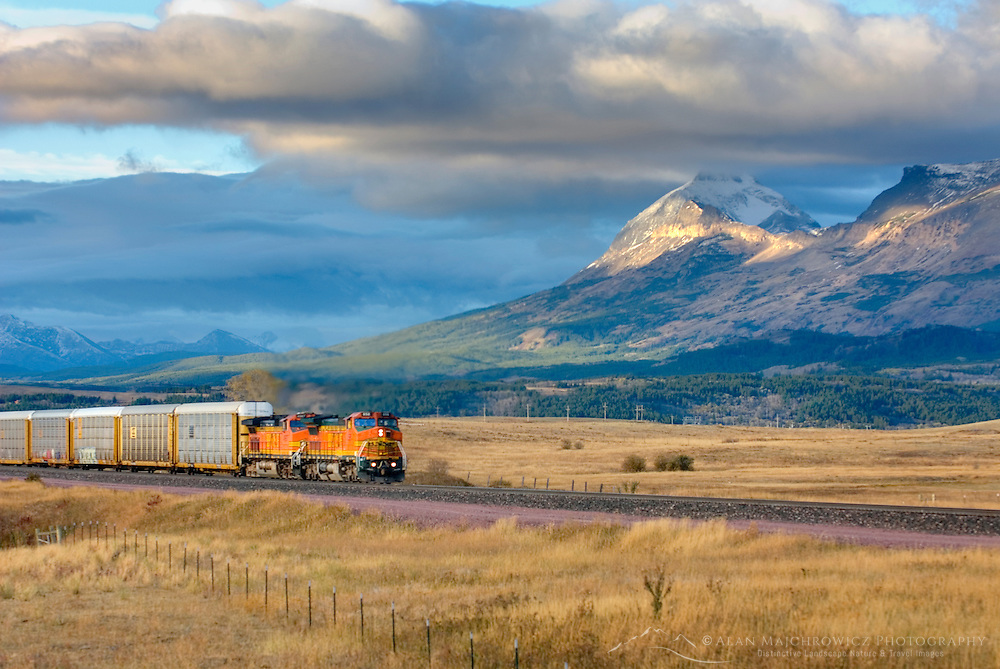 Freight train on the Montana plains near the Rocky Mountain Front Ranges of Glacier National Park USA