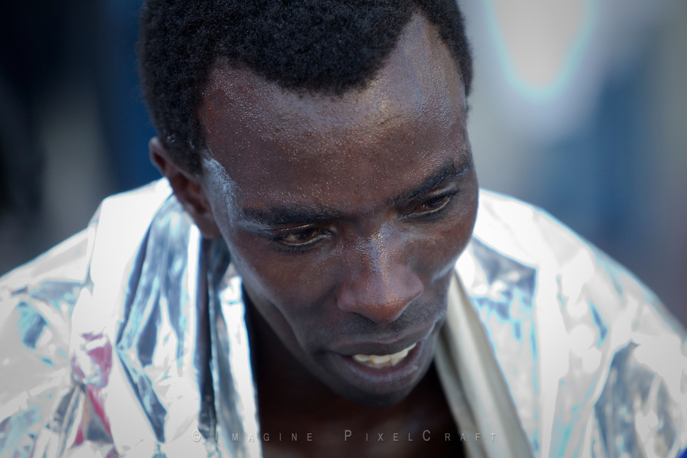 Photo of Leonard Mania-Mucheru approaching the finish line at the Quad Cities Marathon 2010.