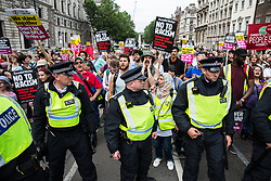 London, UK. 9th June, 2018. Anti-fascists protest against the far-right March for Tommy Robinson in Parliament Street.