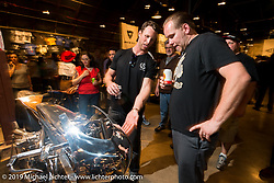 Max Hazan gives Casey Ketterhagen a tour of his antique that he just rebuilt on Saturday at the Handbuilt Motorcycle Show. Austin, TX. April 11, 2015.  Photography ©2015 Michael Lichter.