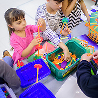 Arabella Romero, center, Bernadetta Sullenger and other children build models from plastic blocks during the Science Technology Engineering Arts and Mathematics Forum at Stagecoach Elementary School in Gallup Saturday.