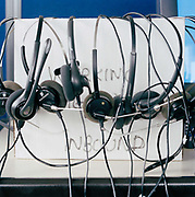 Multiple microphones,  necessary for the work of a call centre. From the series Desk Job, a project which explores globalisation through office life around the World.
