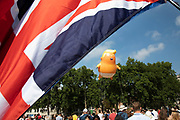 The Trump Baby, a six metre high inflatable blimp flying above the Houses of Parliament in Westminster prior to the Together Against Trump national demonstration on 13th July 2018 in London, United Kingdom. Organisations The Stop Trump Coalition and Stand Up to Trump have come together for a one-off national demonstration to protest against President Trump's policies and politics during his official UK visit.