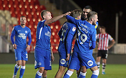 Jason Cummings of Peterborough United is congratulated by team-mates after scoring - Mandatory by-line: Joe Dent/JMP - 04/12/2018 - FOOTBALL - St James Park - Exeter, England - Exeter City v Peterborough United - Checkatrade Trophy