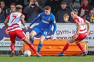 AFC Wimbledon defender Steve Seddon (15) taking on Doncaster Rovers attacker Mallik Wilks (7) and Doncaster Rovers defender Aaron Lewis (44) during the EFL Sky Bet League 1 match between AFC Wimbledon and Doncaster Rovers at the Cherry Red Records Stadium, Kingston, England on 9 March 2019.