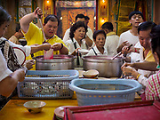 16 OCTOBER 2018 - BANGKOK, THAILAND: Lunch at Chit Sia Ma Shrine in Bangkok's Chinatown durng the Vegetarian Festival, also called the Nine Emperor Gods Festival. The Nine Emperor Gods Festival is a nine-day Taoist celebration beginning on the eve of 9th lunar month of the Chinese calendar.     PHOTO BY JACK KURTZ