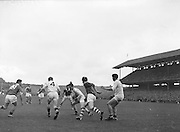 Galway player attempts to keep possession while surrounded by players during the All Ireland Minor Gaelic Football Final Cork v. Galway in Croke Park on the 26th September 1960.