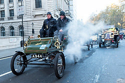 © Licensed to London News Pictures. 06/11/2016. London, UK. Participants taking part in the 120th Bonhams London to Brighton Veteran Car Run depart from central London.  The Run commemorates the Emancipation Run of 14 November 1896, which celebrated the Locomotives on the Highway Act, when the speed limit for 'light locomotives' was raised from 4 mph to 14 mph, abolishing the need for vehicles to be preceded by a man on foot.  The 60 mile journey is undertaken by 400 pre-1905 manufactured vehicles, some of which suffer frequernt breakdowns. Photo credit : Stephen Chung/LNP