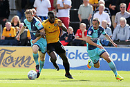 Frank Nouble of Newport County © tries to go past  Craig Mackail-Smith (l) and Adam El-Abd of Wycombe Wanderers. EFL Skybet football league two match, Newport county v Wycombe Wanderers at Rodney Parade in Newport, South Wales on Saturday 9th September 2017.<br /> pic by Andrew Orchard, Andrew Orchard sports photography.