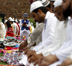 June 26, 2017 - Delhi, New Delhi, India - An Indian Muslim Kid Busy i Mobile Phone During Eid al-Fitr Namaz festival, which marks the end of the fasting month of Ramadan at Firoz Saha Kotla in Delhi on Monday. (Credit Image: © Shrikant Singh/Pacific Press via ZUMA Wire)