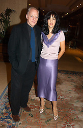 Musician DAVID GILMOUR and his wife writer POLLY SAMPSON at the Conde Nast Traveller magazine Tsunami Appeal Dinner at the Four Seasons Hotel, Hamilton Place, London W1 on 2nd March 2005.<br /><br />NON EXCLUSIVE - WORLD RIGHTS