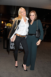 Left to right, AMANDA CRONIN and CAROLE SILLER at the launch of Samsung's NX Smart Camera at charity auction with David Bailey in aid of Marie Curie Cancer Care at the Bulgari Hotel, 171 Knightsbridge, London on 14th May 2013.