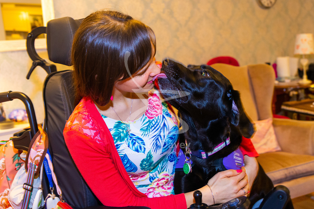 Ethan gives Sally a kiss, their strong bond always apparent. Illnesses in her teens has left Sally Whitney from Brighton, who suffers from seizures, in a wheelchair and dependent on her assistance dog Ethan. The highly trained black Labrador can get help when she needs it , can fetch and put things away for her, and can even pay for shopping with contactless payment cards. Brighton, March 02 2019.