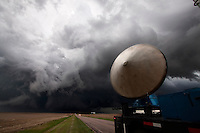A radar truck with Project Vortex 2 scans a storm in the panhandle of Nebraska, June 5, 2009.   Project Vortex 2 is a two year National Science Foundation and NOAA funded science mission to study tornadoes and supercell thunderstorms.
