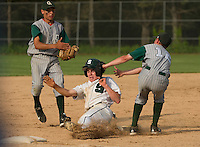 Mike Platt gets tagged out by Dawson McCowen of Colebrook during semi final Division IV baseball at Plymouth State University Wednesday evening.  (Karen Bobotas/for Valley News)