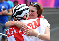 England's Evie Richards celebrates winning silver with relatives in the Women's Cross-Country at the Nerang Mountain Bike Trails during day eight of the 2018 Commonwealth Games in the Gold Coast, Australia.