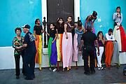 Stilt walkers prepares to parade in the Festival of San Sebastian in San Juan, Puerto Rico.