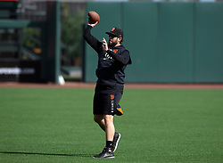 Oct 7, 2021; San Francisco, CA, USA; San Francisco Giants pitcher Dominic Leone (52) throws a football around the outfield during NLDS workouts. Mandatory Credit: D. Ross Cameron-USA TODAY Sports