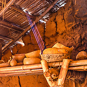 At the Frontier Museum in Staunton, VA, the walk starts with a wet African home.  This shelf was inside with some typical artifacts.  The roof is made of sticks and yes, those really are natural light beams coming in.