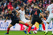 Mateo Kovačić (Croatia) comes in to take the ball from Ross Barkley (England) during the UEFA Nations League match between England and Croatia at Wembley Stadium, London, England on 18 November 2018.