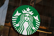Sign for the coffee shop and brand Starbucks in Birmingham, United Kingdom.