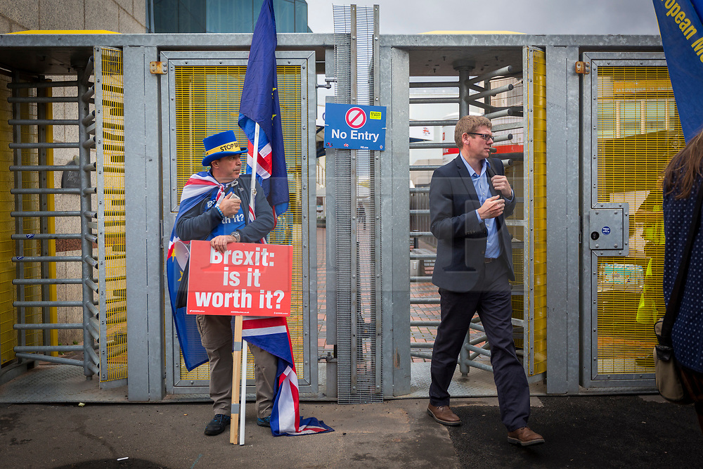 © Licensed to London News Pictures. 02/10/2018. Birmingham, UK. Anti Brexit protesters outside the Conservative party conference today as people leave the conference for the day at the International Convention Centre in Birmingham. Photo credit: Andrew McCaren/LNP