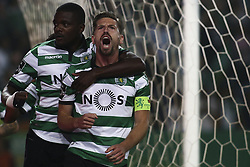 April 22, 2017 - Lisbon, Portugal - Sporting's midfielder Adrien Silva (R) celebrates with Sporting's midfielder William Carvalho after scoring a goal during the Portuguese League  football match between Sporting CP and SL Benfica at Jose Alvalade  Stadium in Lisbon on April 22, 2017. (Credit Image: © Carlos Costa/NurPhoto via ZUMA Press)